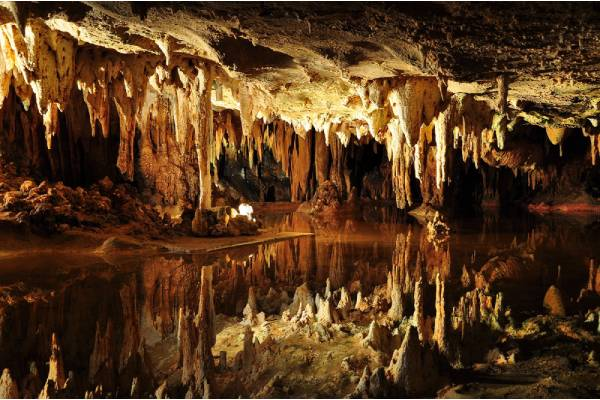 Cave stalactites and formations reflected in the water at Luray Caverns, Virginia.