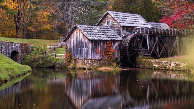 Image Showing A Lonely Calm Wooden House along with river
